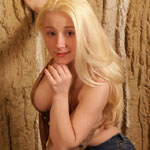 Blonde Cutie Busts Out Of Suede Top - Picture 15